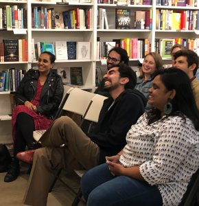 An image of the audience listening to a reader